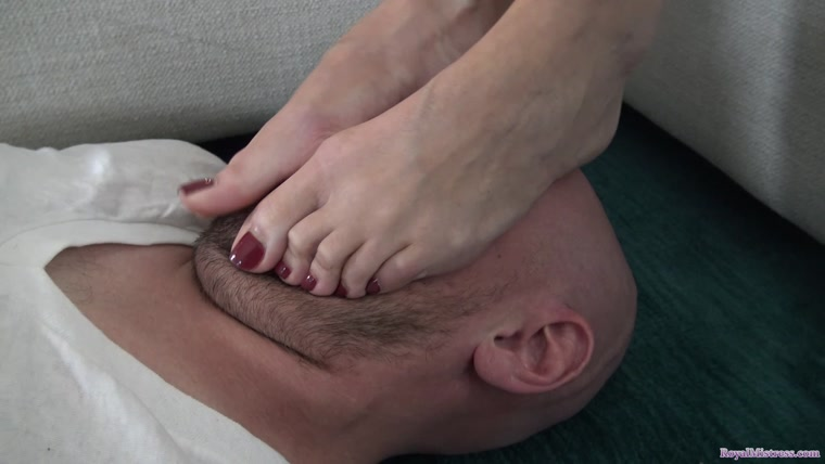 Mistress Stella amuses herself by smothering her slave's face with her feet until he can't breathe